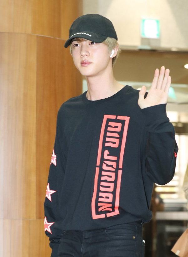 Jin of BTS is saying hello in the afternoon of 5 April, before departing for Thailand for their concert via charter flight from the Gimpo International Airport 2019.4.5/News 1 © News 1